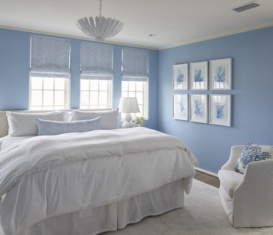 bright blue walls and a white bed