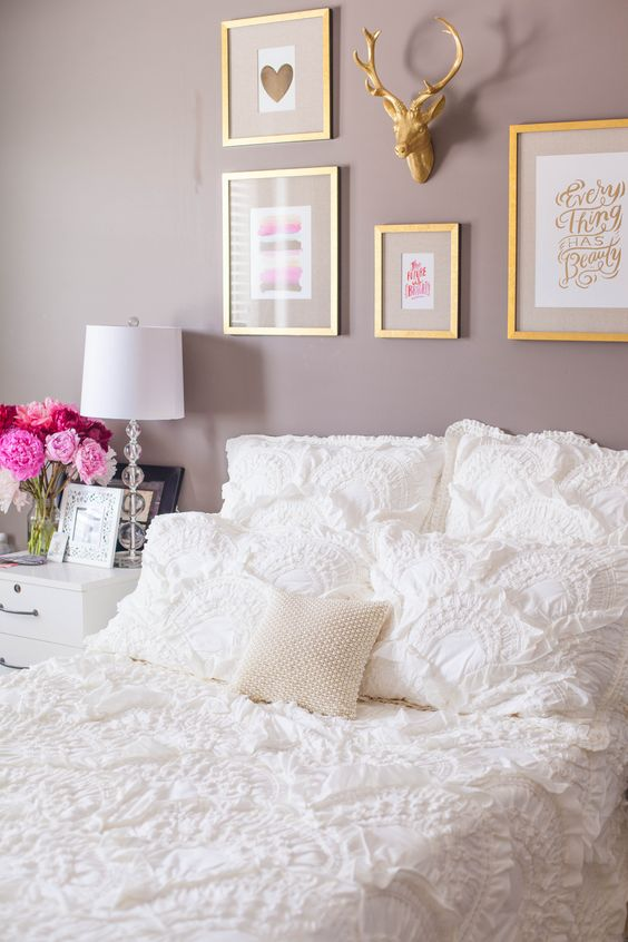 photo frames and a white bed