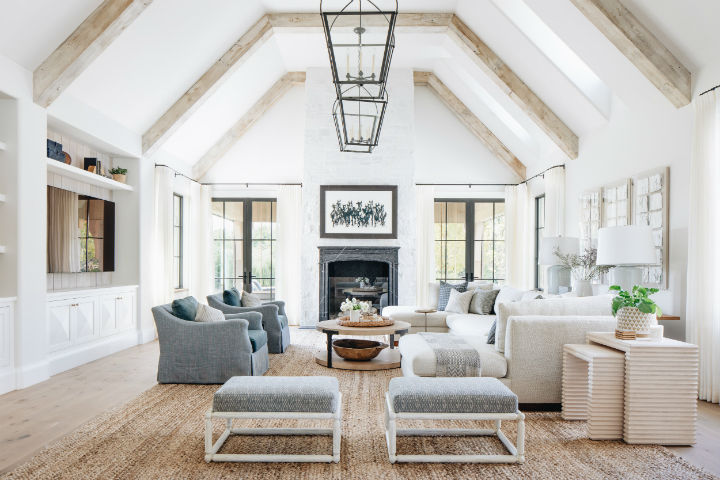 transitional living room with high ceiling