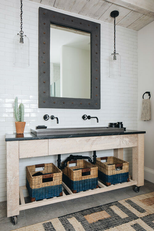modern wood and black bathroom with black faucets