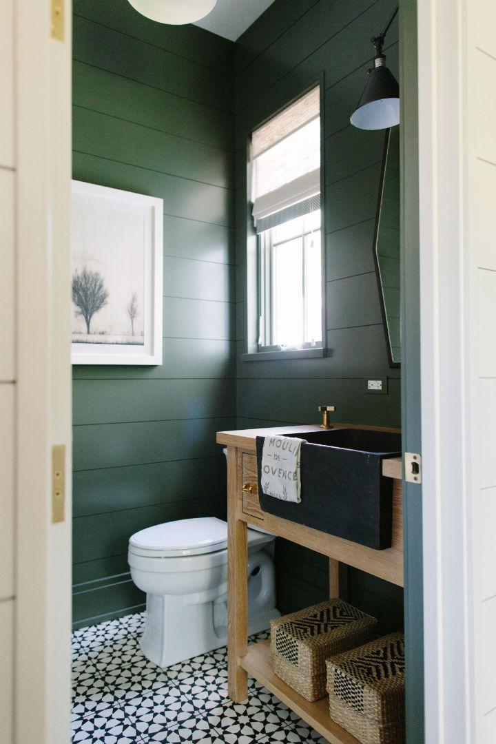 dark green traditional powder room