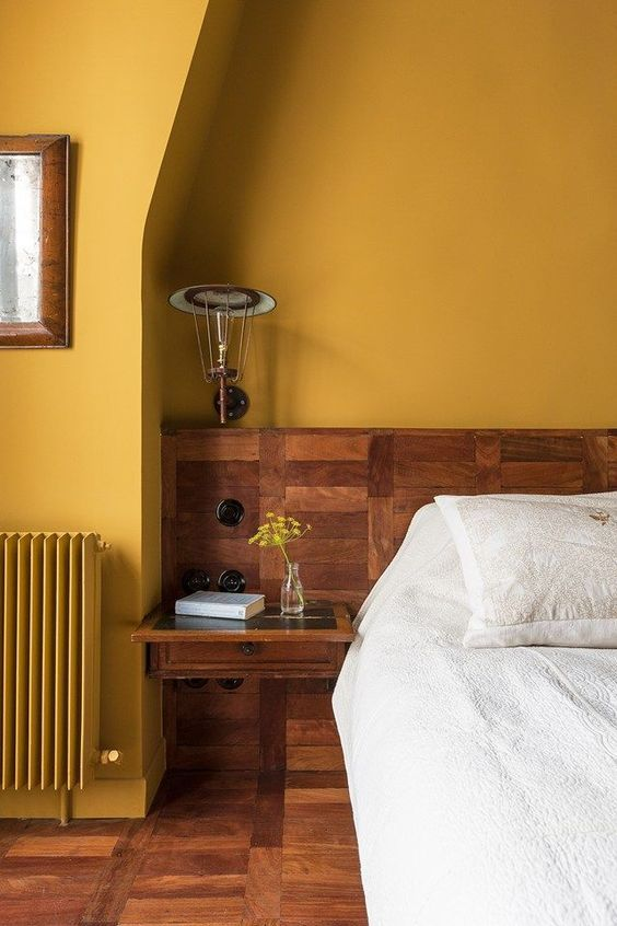 wooden flooring and yellow wall