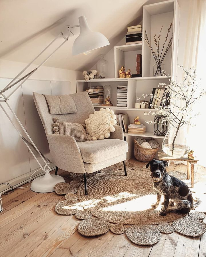 beige armchair and a dog