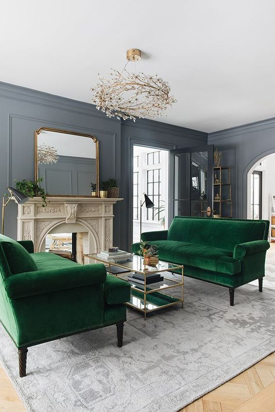 green velvet couches in a living room