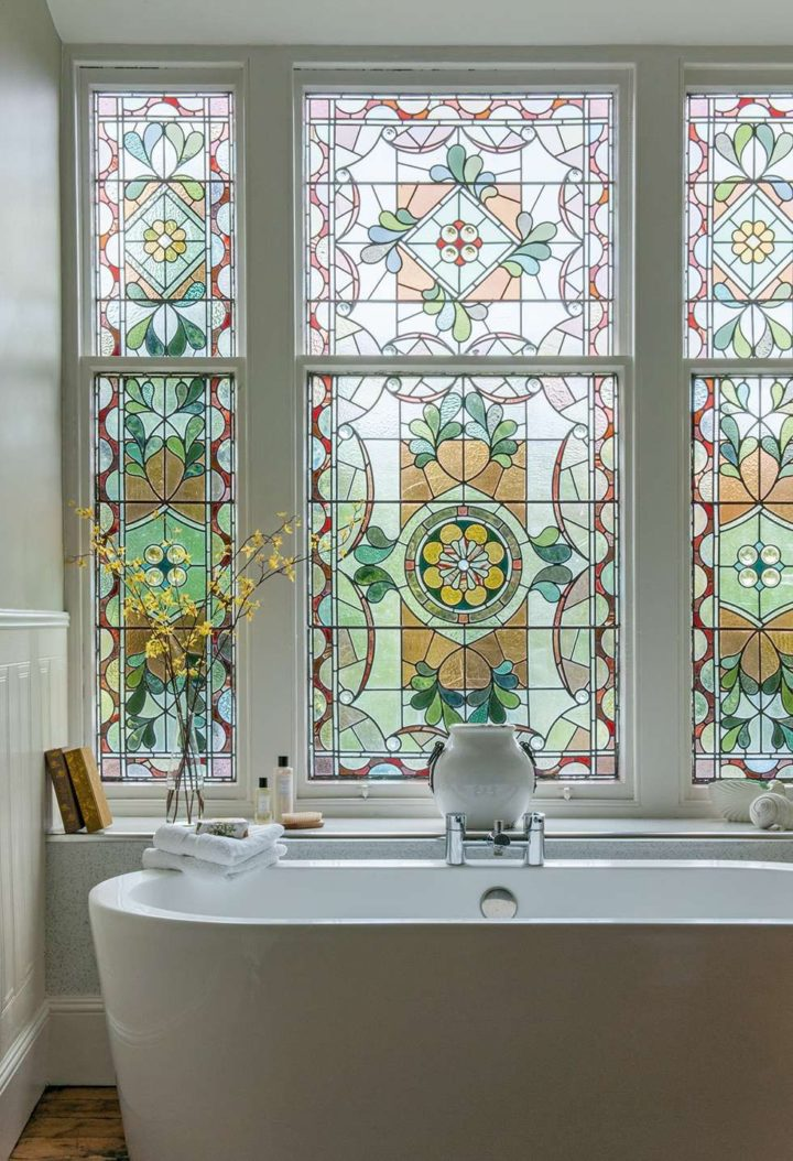 windows with patterns in bathroom