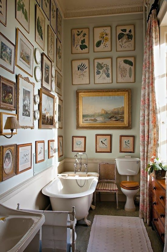 many frames on bathroom wall