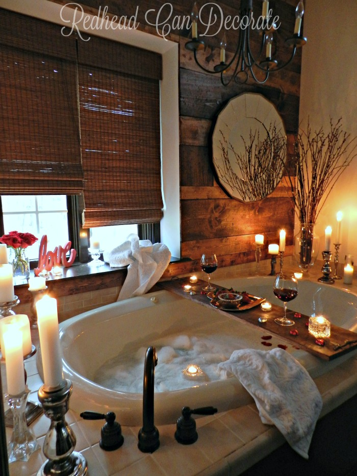 big bathtub with candles and wine