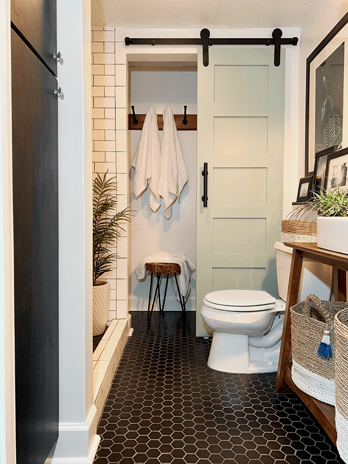 bathroom with black flooring