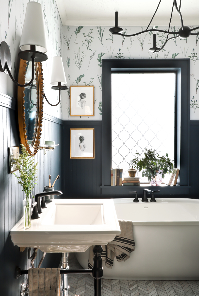 small black and white romantic bathroom with wallpaper