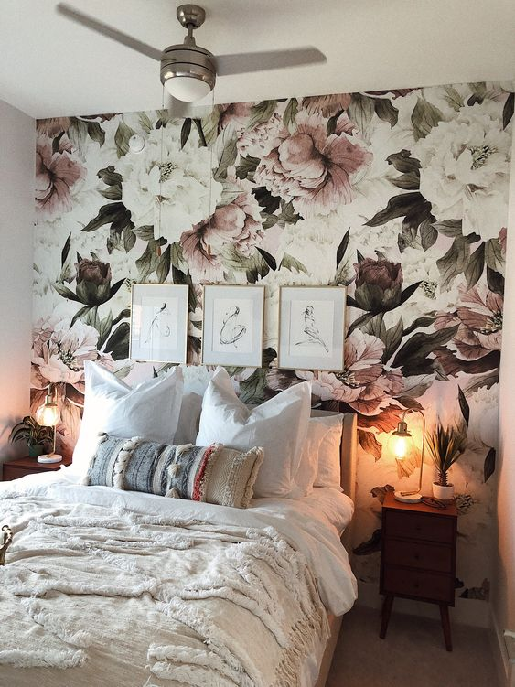 floral wall above bed