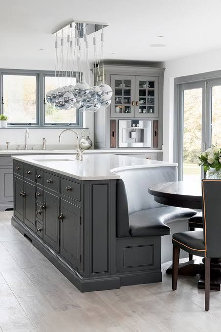 grey kitchen island with curved bench