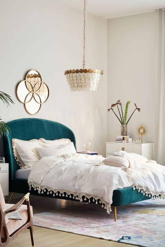 teal bed with white sheets