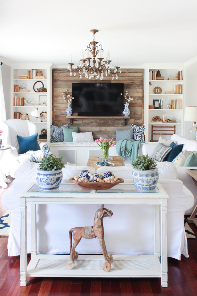small white living room with wood TV wall