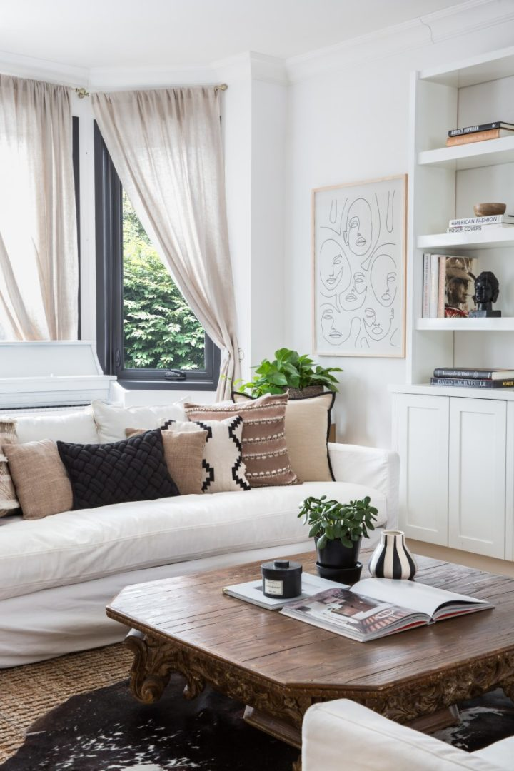 white sofa with brown and beige pillows