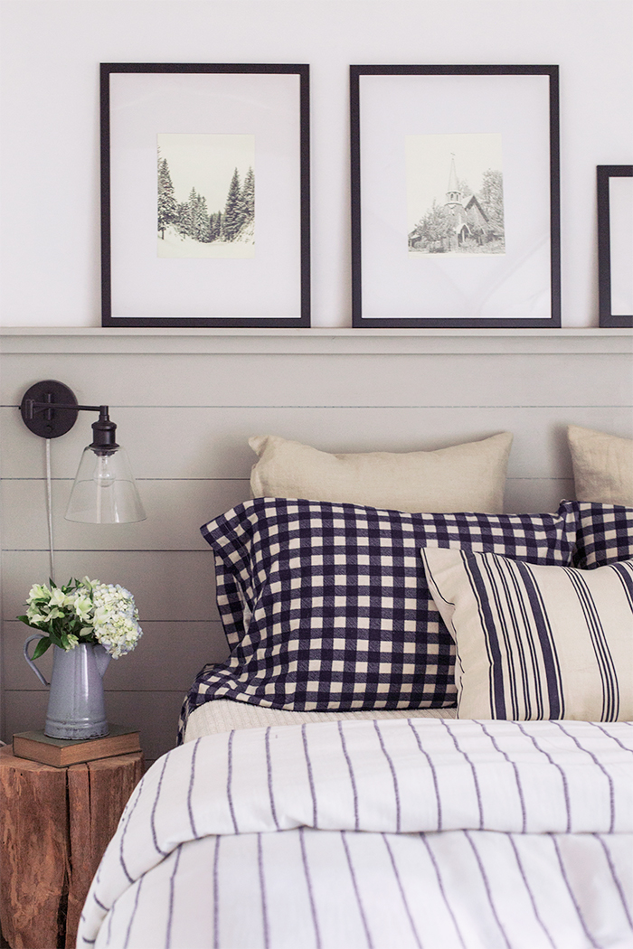 country bedroom with nave and white checkered pillows