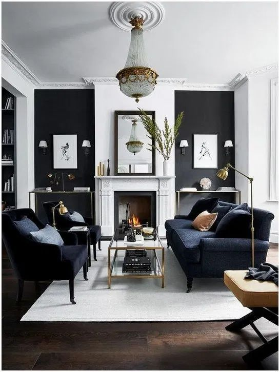 living room with black and white walls and gold chandelier