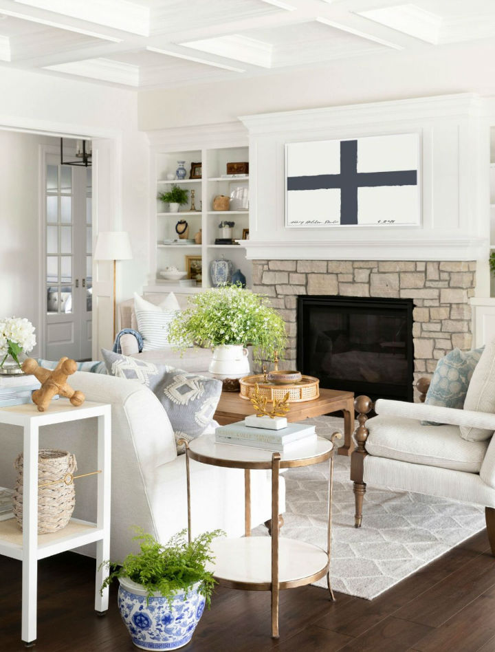 beautiful and inviting white fireplace area