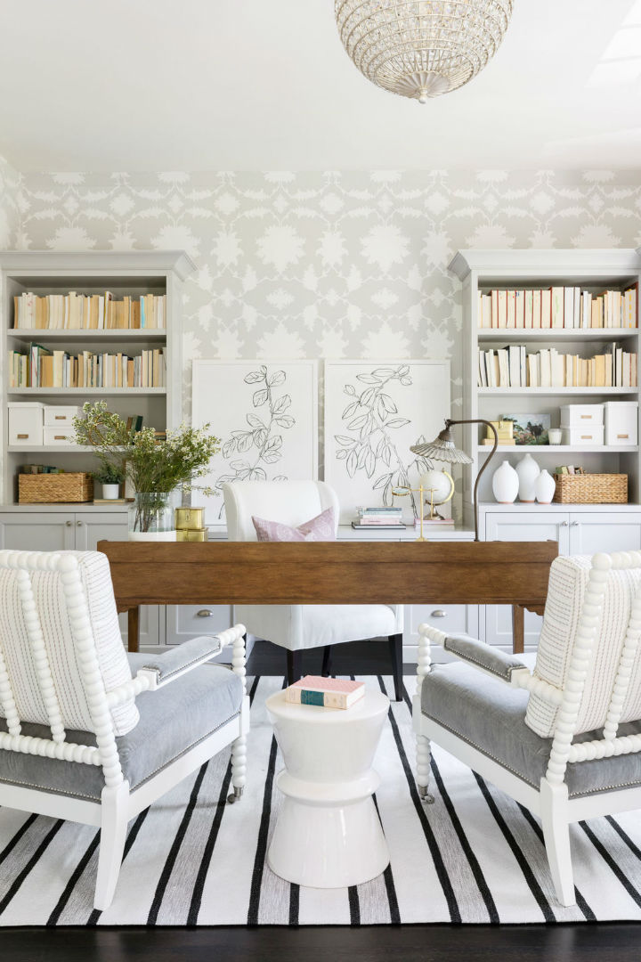 white sitting area with bookshelves