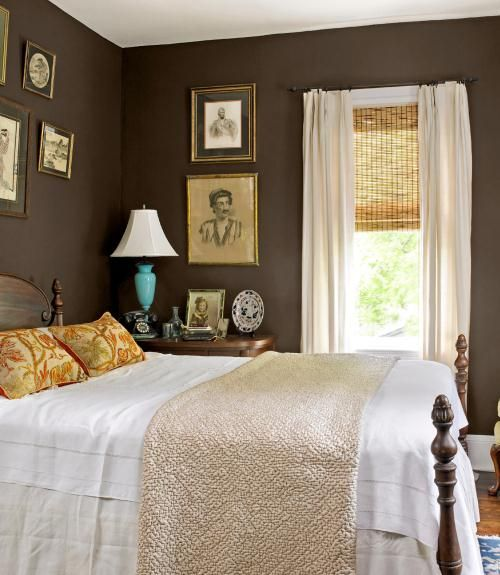brown bedroom wall with frames on it