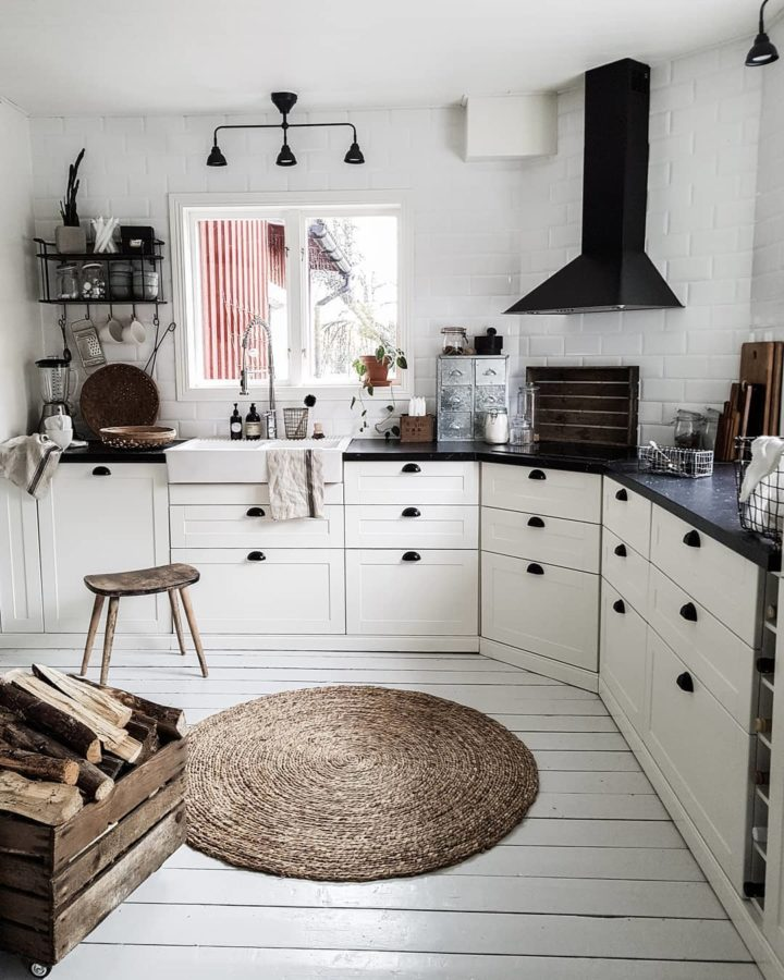 white kitchen with brown rug