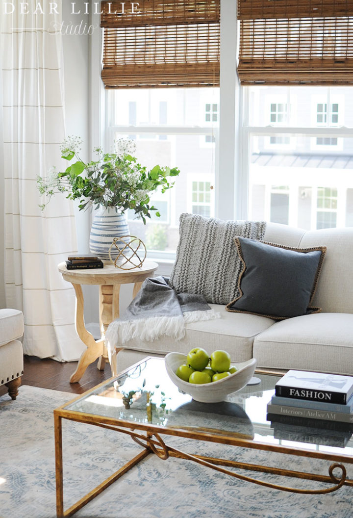 cozy living room corner with white sofa flowers