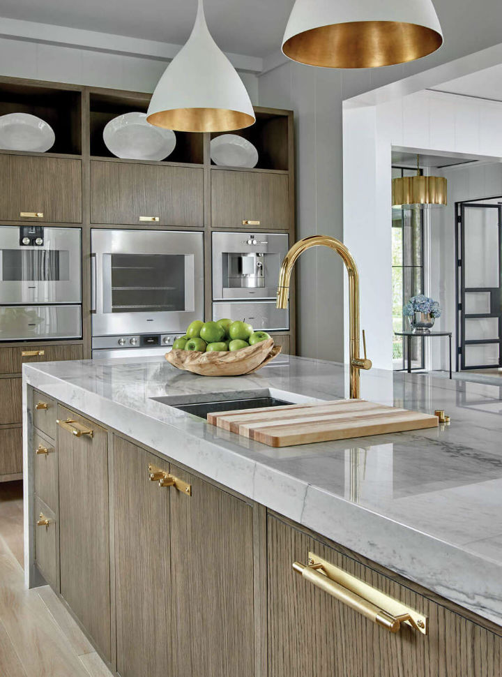 gold kitchen sink with pendant lights