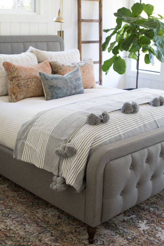 white pink and gray double bed