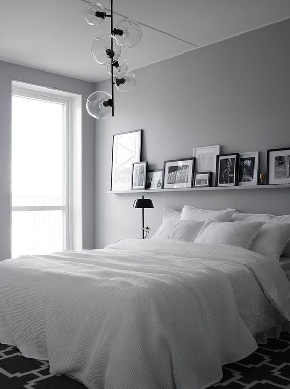 shades of grey in bedroom with white bed