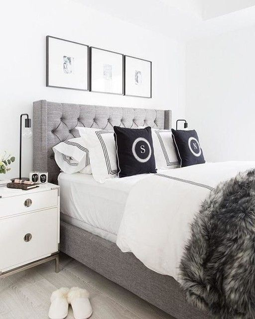 white bed with black pillows
