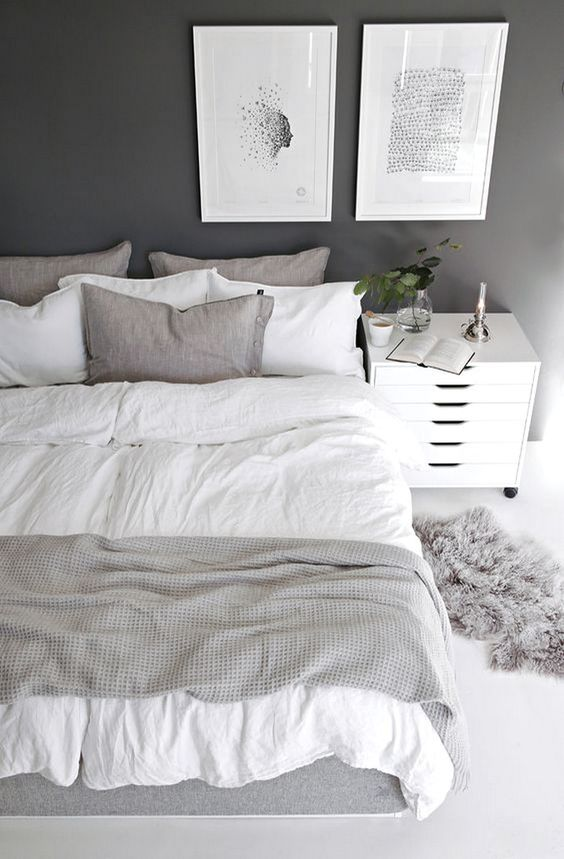 white and gray bedroom with white nightstand