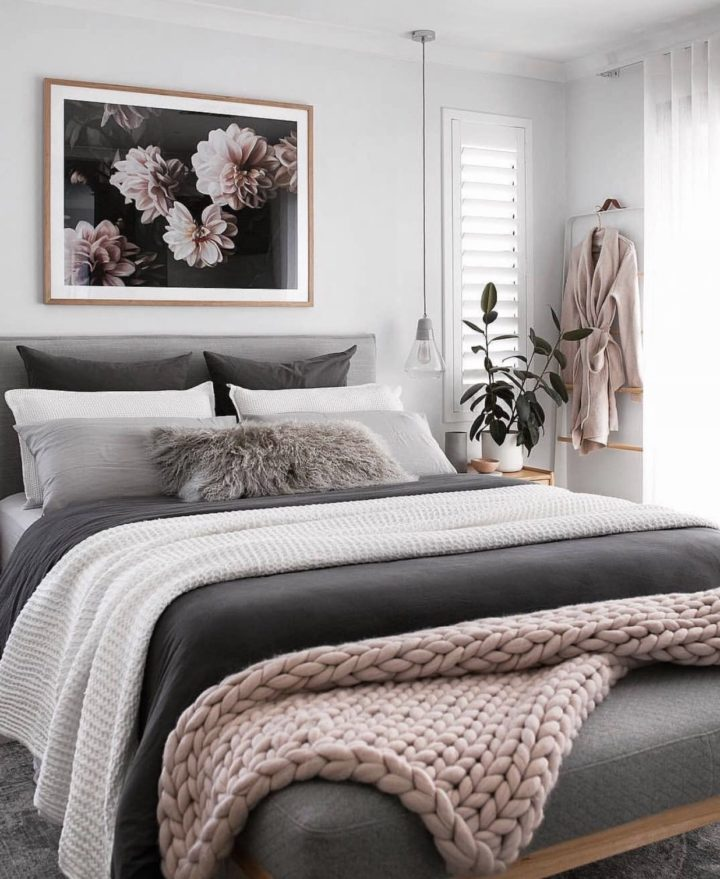 gray bed with pink rug