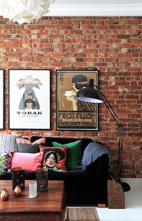 industrial living room with brick wall and floor lamp