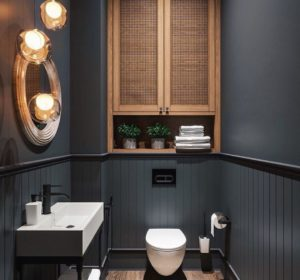 small black bathroom with wood furniture