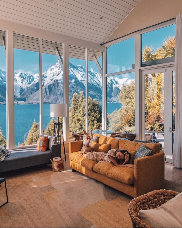 big windows in a brown living room decor