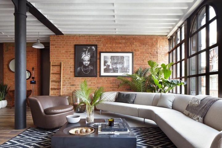 big sectional and exposed bricks