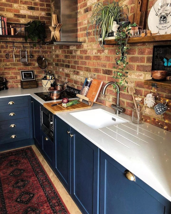 indigo kitchen on a budget with brick wall
