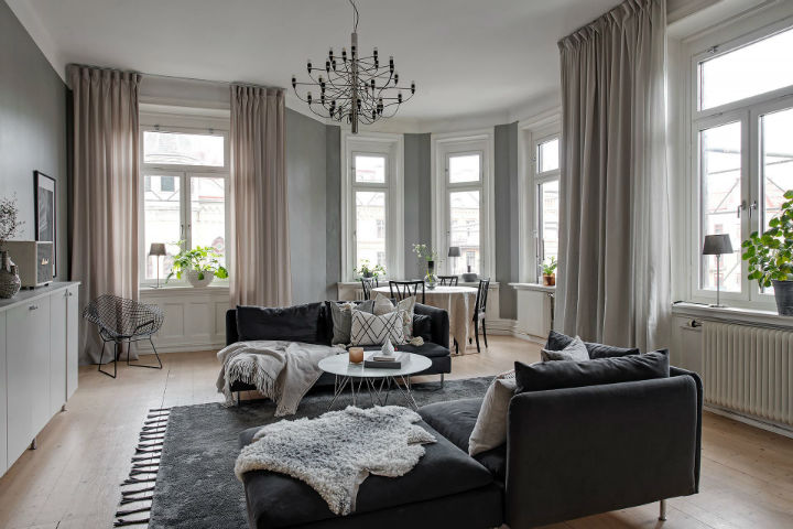 living room with grey sofas