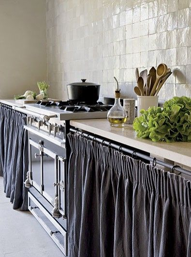 French Country Kitchen uses cabinet curtains