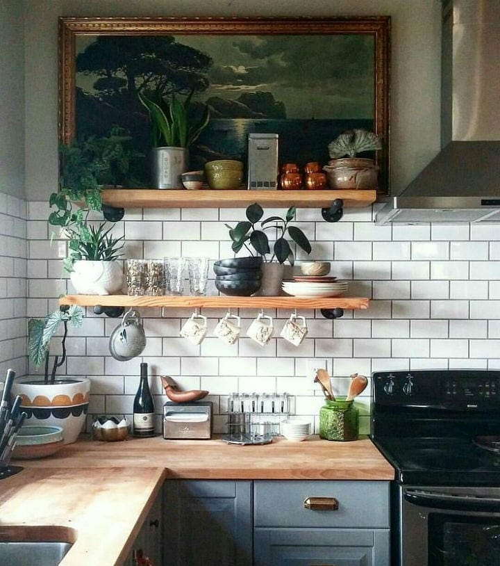 kitchen with open shelves decorative items and art