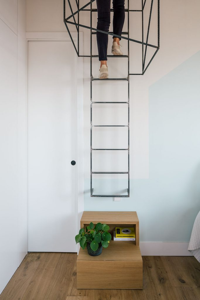 woman climbing indoor ladder