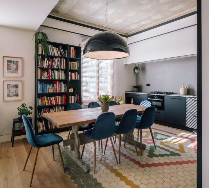 unique apartment with blue chairs dining room