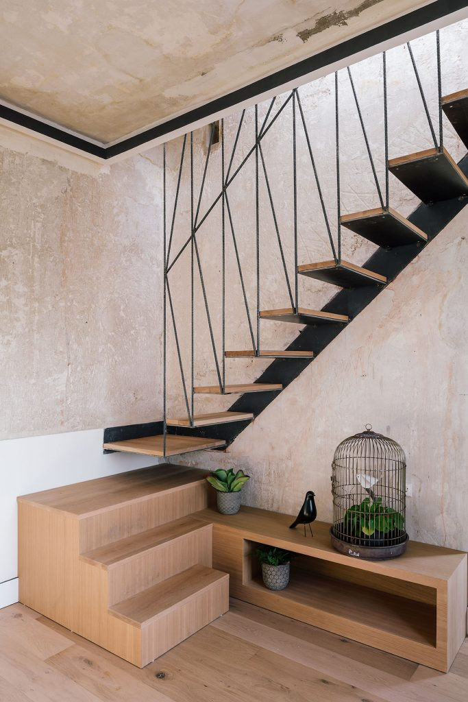 two colored stairs in unique apartment