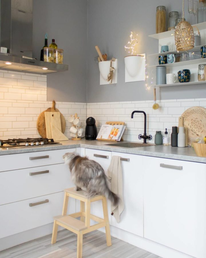 IKEA modern white kitchen with grey shelves and open shelves