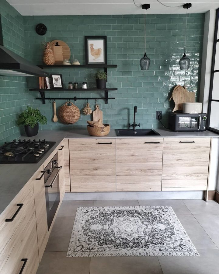 modern wood kitchen with green tiles