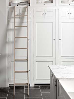 rail designed along the top of a run of full-height cabinets