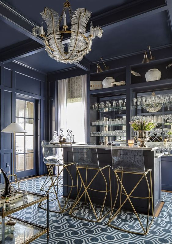 luxury deep blue bar with glass chairs