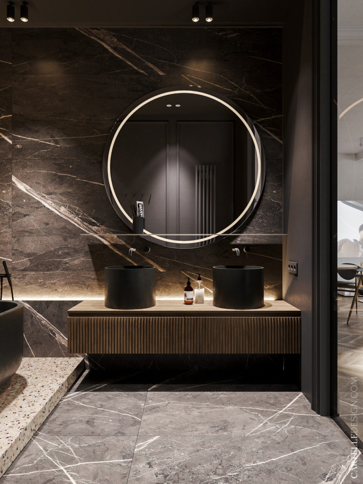 Marble bathroom with circle mirror