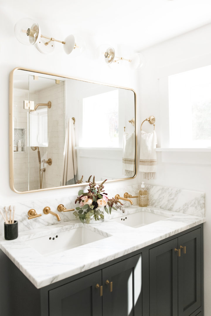 Bright white bathroom with square mirror