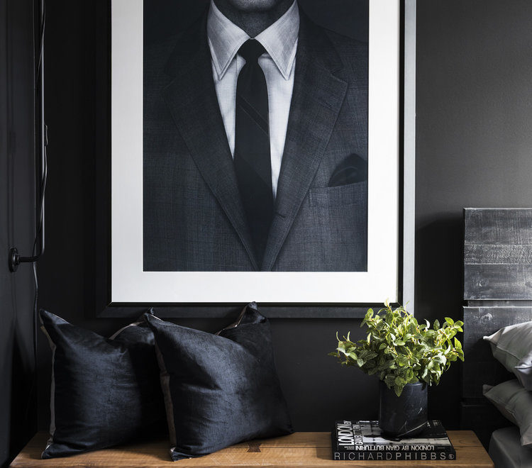 bedroom idea for men with black wall and black and white photography art