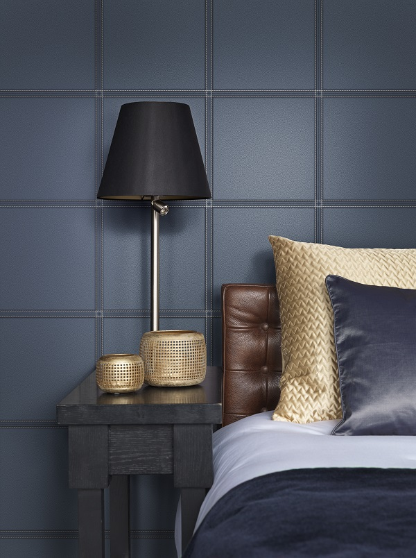Dark men's bedroom idea with square wallpaper